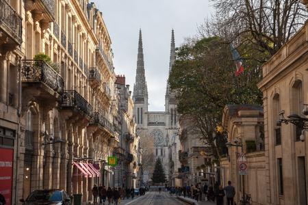 BORDEAUX, FRANCE - DECEMBER 27, 2017: Bordeaux Cathedral seen from Vital Street in the historic medieval part of the city. The cathedral is one of the biggest symbols of the city 에디토리얼