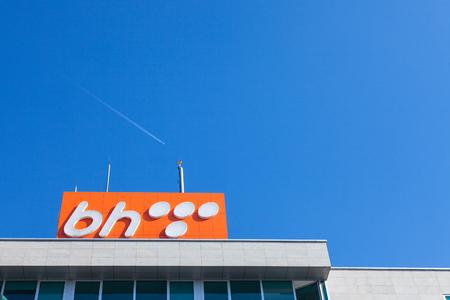 SARAJEVO, BOSNIA - FEBRUARY 16, 2018: BH Telecom logo on a sign on their headquarters in Sarajevo. BH Telecom is the main telecommunication company in Bosnia  Picture of the logo of BH Telecom taken on their main office in Sarajevo, Bosnia and Herzegovina