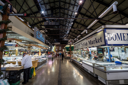 TORONTO, CANADA - DECEMBER 20, 2016: Interior of St. Lawrence Market with fish market stalls in the early morning. St. Lawrence Market is one of the main landmarks of Toronto