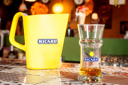 MARSEILLE, FRANCE - MARCH 15, 2018: Close up of a Ricard jug and a water bottle with its logo. Ricard is a pastis, anise and licorice flavored aperitif typical from Southern France