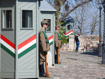 BUDAPEST, HUNGARY - APRIL 8, 2017: Hungarian army guards formally wathcing the Sandor Palace, the presidential castle of Hungary, during a warm afternoon Editorial
