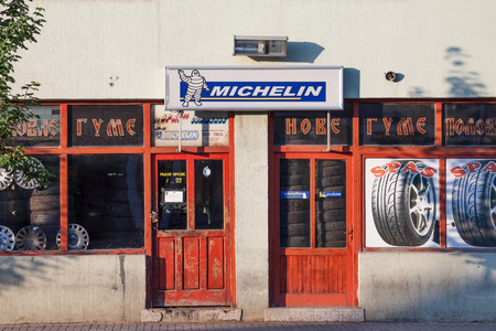 INDJIJA, SERBIA - MAY 20, 2018: Michelin logo on a tire store in a Serbian garage. Michelin is a French tire manufacturer spread wordlwide