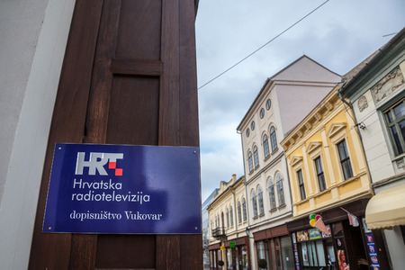 VUKOVAR, CROATIA - FEBRUARY 25, 2018: HRT logo on your office in Vukovar. HRT, or Hrvatska Radiotelevizija, or Croatian Radiotelevision, is the public television and radio channels of the State