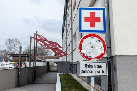 VUKOVAR, CROATIA - FEBRUARY 25, 2018: Entrance of the Vukovar Hospital memorial with its iconic red cross, a memorial dedicated to the massacre that occured there during the Yugoslav WarPicture of the memorial in the Vukovar hospital, with its monumenta