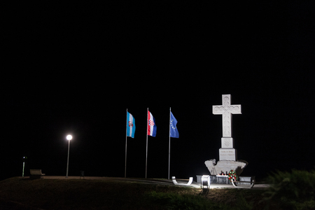 VUKOVAR, CROATIA - MAY 13, 2018: Mace dedicated to the defenders of Vukovar in the Homeland war of 1991-1995, made of a Christian cross with European and Croatian flags