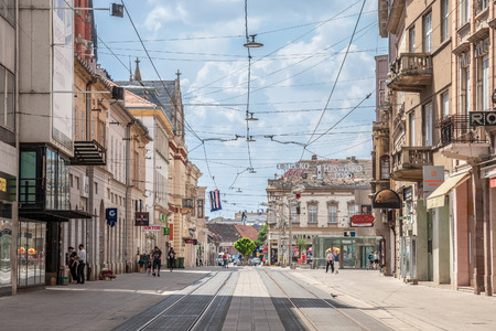 OSIJEK, CROATIA - MAY 12, 2018: Main Street of Osijek, Ulica Strossmayera Street, with pedestrian and tramway paths. Osijek is the main city of Northern Croatian region of Slavonia