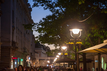 BELGRADE, SERBIA - APRIL 22, 2018: Kneza Mihailova street at night, crowded, with blurred people rushing. Also known as Knez Mihaila, this is the main street of the city