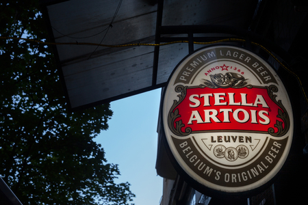 BELGRADE, SERBIA - JUNE 23, 2018: Logo of Stella Artois on a bar sign with its distinctive visual. Stella Artois is a Belgian light pilsner beer produced in Leuven by the Artois brewery, belonging to Interbrew BV