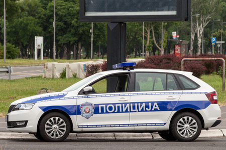 BELGRADE, SERBIA - MAY 25, 2018: Skoda brand Serbian police car patrolling in Belgrade. It belongs to the civilian police force of the country, also known as Policija Éditoriale