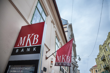 SZEGED, HUNGARY - JULY 4, 2018: MKB Bank logo on their main office for Szeged in the city center. MKB is one of the biggest domestics banks of Hungary  Picture of the MKB Bank sign on their agency for Szeged in Hungary. MKB Bank is the fourth-biggest comm