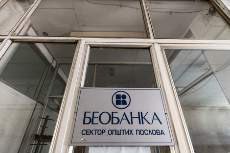 BELGRADE, SERBIA - JULY 19, 2018: Beobanka logo on their former main office in Belgrade. Beobanka was a yugoslav bank that went bankrupt in 2002 and is curretly in liquidation  picture of a Beobanka sign on their former headquarters for Belgrade, Serbia.
