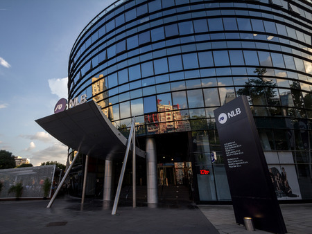 BELGRADE, SERBIA - JULY 26, 2018: NLB Bank Group logo on their main office for Serbia. NLB Group, formerly Ljubljanska Banka, is a Slovenian bank & financial services group spread in Balkans  Picture of the NLB Group sign with their logo on their headquar