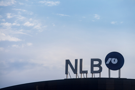 BELGRADE, SERBIA - AUGUST 1, 2018: NLB Bank Group logo on their main office for Serbia. NLB Group, formerly Ljubljanska Banka, is a Slovenian bank & financial services group spread in Balkans  Picture of the NLB Group sign with their logo on their headqua