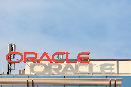 BELGRADE, SERBIA - AUGUST 21, 2018: Oracle logo on their main offices for Belgrade, Serbia. Oracle is an American multinational computer technology corporation  Picture of the oracle sign on their office in Belgrade, Serbia. Oracle is a multinational comp Editorial