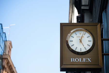 BELGRADE, SERBIA - SEPTEMBER 9, 2018: Rolex logo on a clock on their retailer in Belgrade. Rolex is a Swiss luxury watchmaker specialized in watches and precision time instruments   Picture of the Rolex sign on a clock on their shop in Belgrade, Serbia. R