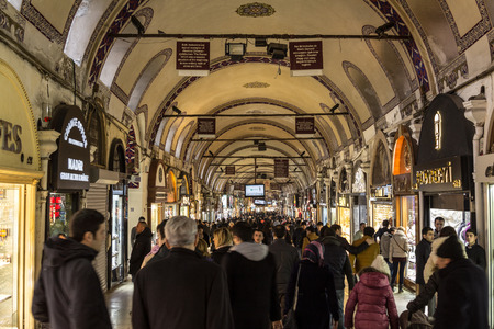 ISTANBUL, TURKEY - DECEMBER 30, 2015: Crowded street in the Grand Bazaar during rush hour. The Grand Bazaar is one of the main landmarks of the city, on the European sideAlso known as Kapalicarsi, it is one of the largest and oldest covered markets in t