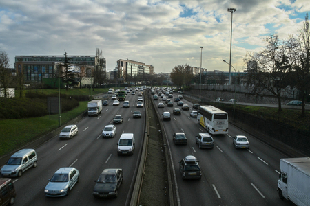 PARIS, FRANCE - DECEMBER 30, 2007: Cars passing by on the Boulevard Peripherique ring road of Paris during rush hour. It is one of the main expressways of the capital city of France