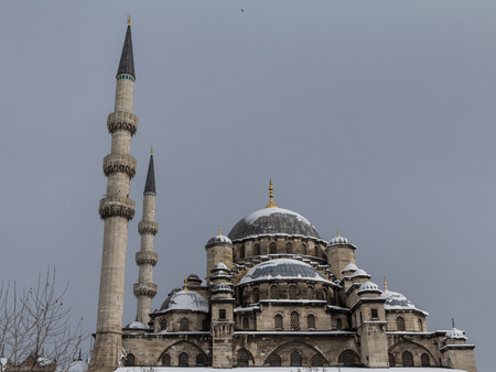 Eminonu Mosque, also known as New Mosque, or Yeni Cami, in Istanbul, Turkey, covered in snow during a winter afternoon. It is one of the main Ottoman landmarks and tourist attractions in the city Stock fotó