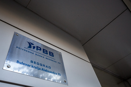 BELGRADE, SERBIA - SEPTEMBER 23, 2018: PBB logo on their former main office in Belgrade. Also known as Privredna Banka Beograd, it was a serbian bank that went bankrupt in 2013 and is curretly in liquidation  picture of a PBB Banka sign on their former he Sajtókép