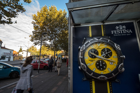 BELGRADE, SERBIA - SEPTEMBER 27, 2018: Festina logo on a billboard in front of their main retailer in Belgrade. Festina is a Swiss Spanish watch brand and producer  Picture of a sign with the Festina logo on the shop of their main retailer in Belgrade, Se