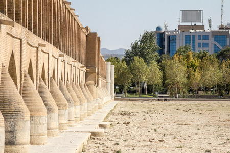 If o Seh Pol bridge seen from one of its banks on the afternoon with the dry Zayandeh river, in Isfahan, Iran. Also known as Allahverdi Khan Bridge, it is a major landmark of the city