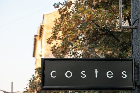 BELGRADE, SERBIA - OCTOBER 9, 2018: Costes logo on their concept store Belgrade. Hotel Costes is a major Paris hotel in France, with affiliated bars, cafes and fashion concept stores worldwide  Picture of the Costes sign with their logo on their shop in B