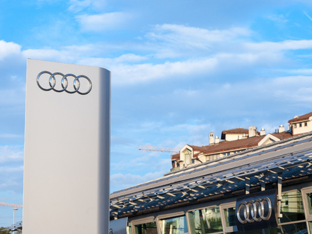 BELGRADE, SERBIA - OCTOBER 7, 2018: Audi logo on their main dealership store in Belgrade. Audi is a German car and automotive manufacturer, specialized in luxury sports vehicles  Picture of the Audi sign with their logo on their car dealearship in Belgrad Editorial