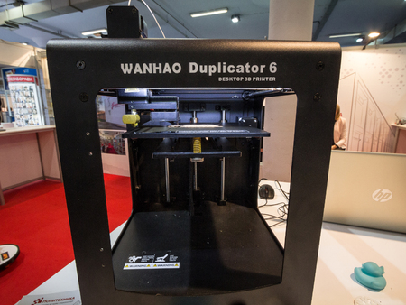 BELGRADE, SERBIA - OCTOBER 25, 2018: Wanhao logo on a 3D printer on display. Wanhao is a Chinese manufacturer of 3D printers and tools, for industrial and house uses  Picture of a Wanhao 3D printer with its distincitive logo, taken on a desktop printer on