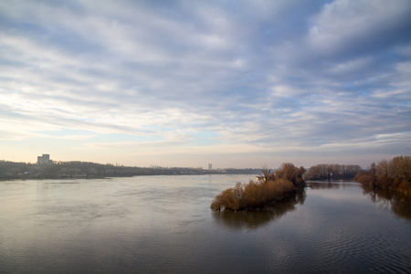 Danube shores in Zemun, suburb of Belgrade, Serbia, during the autumn, with the river in foreground, yellow trees with no leaves in the background. It is the main river of Europe