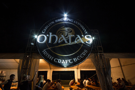 BELGRADE, SERBIA - AUGUST 19, 2018: Giant logo of O'hara's Beer on a summer outdoor bar. O'Hara's, part of the Carlow Brewery group is a irish beer producer