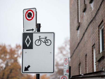 North American standard roadsign indicating a bike lane in Montreal, Quebec. The city is currently developing an alternative