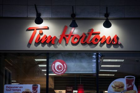 MONTREAL, CANADA - NOVEMBER 5, 2018: Tim Hortons logo in front of one of their restaurants in Montreal, Quebec. Tim Hortons is a cafe and fastfood canadian brand