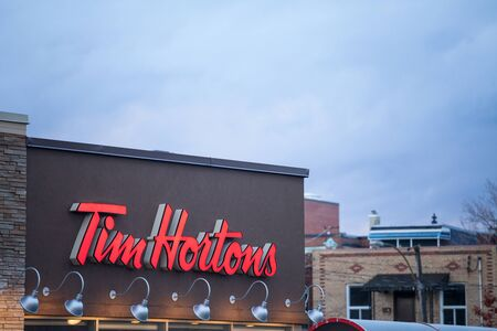 MONTREAL, CANADA - NOVEMBER 6, 2018: Tim Hortons logo in front of one of their restaurants in Montreal, Quebec. Tim Hortons is a cafe and fastfood canadian brand Editorial