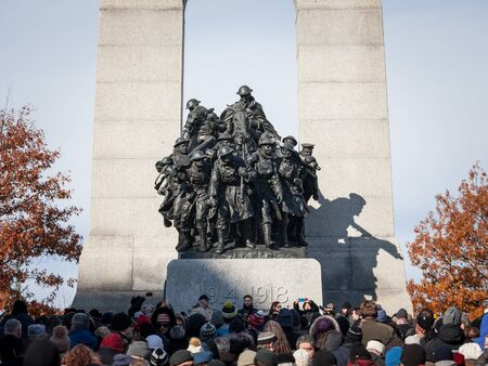 OTTAWA, CANADA - NOVEMBER 11, 2018: Crowd gathering on National War memorial of Ottawa, Ontario, Canada, on remembrance day to commemorate the canadians who died in conflicts Sajtókép