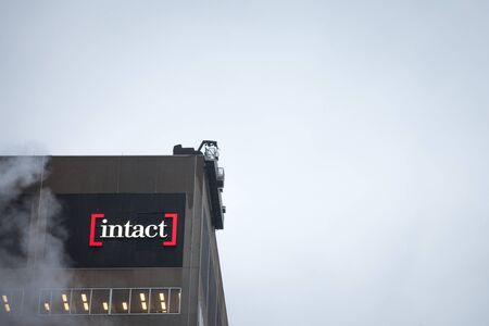 MONTREAL, CANADA - NOVEMBER 5, 2018: Intact financial logo on one of their heaquarters in Montreal, Quebec. Intact Assurance is one of the main Canadian insurance companies Redakční