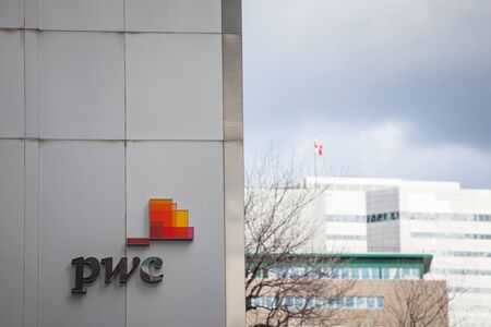 MONTREAL, CANADA - NOVEMBER 7, 2018: PWC logo on their main office for Quebec in Montreal, in a business district. PriceWaterHouseCoopers is one of  main audit firms in the world, within Big Four Group  Picture of PWC logo on a skyscraper in the afternoon