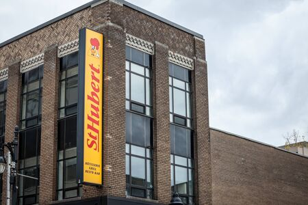 MONTREAL, CANADA - NOVEMBER 8, 2018: St Hubert logo, in front of their local restaurant in Montreal, Quebec. Saint hubert is a Quebec Canadian chain of chicken restaurant and grill