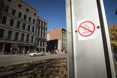 MONTREAL, CANADA - NOVEMBER 3, 2018: Anti Airbnb sticker on the main street of Montreal Port, part of a movement opposing the rental platform and the gentrification of the city  Picture of a sticker with the logo of Airbnb barred by opponents to the websi Editöryel