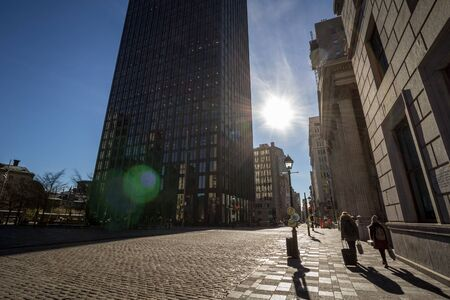 MONTREAL, CANADA - NOVEMBER 4, 2018: Place darmes square seen into the light in the Old Montreal, or vieux Montreal, during a sunny afternoon. It is a landmark of Quebec Editorial