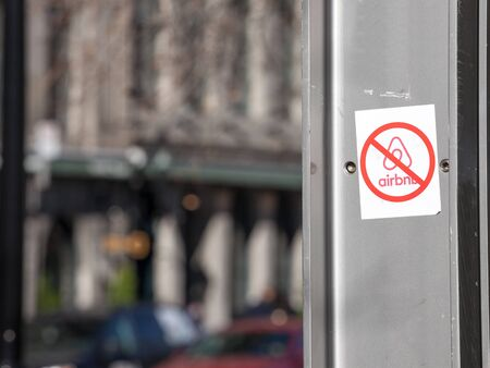 MONTREAL, CANADA - NOVEMBER 4, 2018: Anti Airbnb sticker on the main street of Montreal Port, part of a movement opposing the rental platform and the gentrification of the city