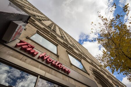 MONTREAL, CANADA - NOVEMBER 7, 2018: Tim Hortons logo in front of one of their restaurants in Montreal, Quebec. Tim Hortons is a cafe and fastfood canadian brand Editorial