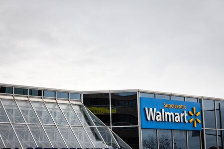 MONTREAL, CANADA - NOVEMBER 9, 2018: Walmart logo in front of one of their supermarket (Supercentre) in Montreal, Quebec. Walmart is one of the biggest American chains of hypermarkets