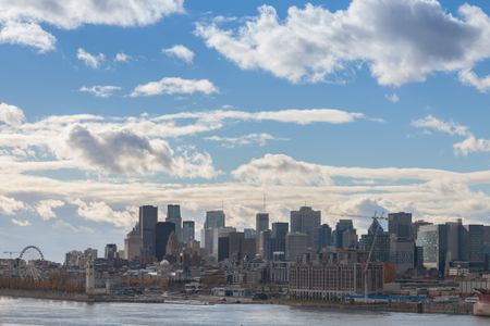 Montreal skyline, with the iconic buildings of the old Montreal (Vieux Montreal) and the CBD business skyscrapers taken from the port.