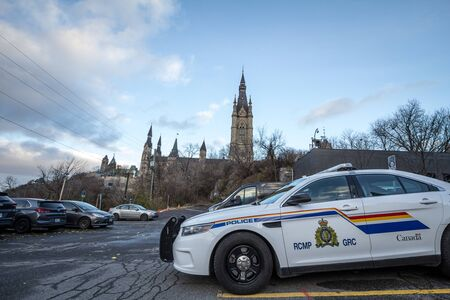 MONTREAL, CANADA - NOVEMBER 10, 2018: RCMP GRC Police car standing in front of the Canadian Parliament Building. The Royal Canadian Mounted Police is the Federal police of CanadaPicture of a car from the RCMP GRC police, parked in front of the Parliamen