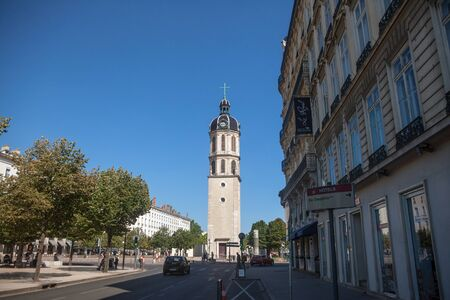 LYON, FRANCE - JULY 19, 2019: Clocher de la Charite Clocktower on the Place Bellecour square in summer. It is the remaining of a former hospital and a major landmark of Lyon CenterPicture of the Place Bellecour Suare in Lyon, France, with the focus on t Éditoriale