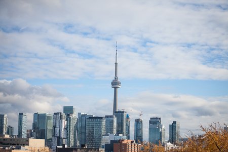 Toronto skyline, with the iconic towers and buildings of the Downtown and the CBD business skyscrapers taken from afar. Tonroto is the main city of Ontario and Canada, and an American finance hub  Picture of the skyline of Toronto, with the main buildings Redakční