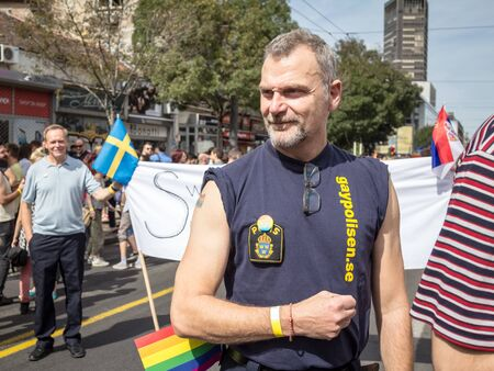 BELGRADE, SERBIA - 18, 2016: Swedish policemen posing during in the Belgrade gay pride in Serbia. The parade, advocating for LGBTQ rights, happened this year without trouble.  Picture of a Swedish gay police officer, belonging to Gaypolisen organization,  Redactioneel