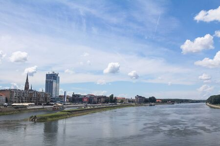 OSIJEK, CROATIA - JUNE 6, 2016: Panorama and skyline of Osijek from Drava river with skyscrapers & the Cathedral of the city. Osijek is a major city of the region of Slavonia in Northern Croatiapicture of the landscape of the city of Osijek, in Croatia,