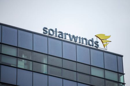 BRNO, CZECHIA - NOVEMBER 5, 2019: SolarWinds logo in front of their office for Brno. SolarWinds is an american IT company specialized in Software development for network infrastructure.Picture of a sign with the logo of SolarWinds taken on their office  Editorial