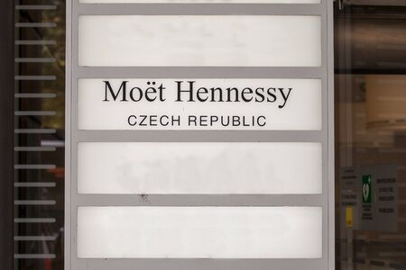PRAGUE, CZECHIA - NOVEMBER 3, 2019:Moet Hennessy logo in front of their office for Czech Republic. Moet Hennessy, part of LVMH, is a French group producing luxury champaign and Cognac.  Picture of a sign with the logo of Moet Hennessy taken in front of th